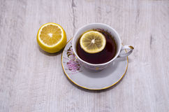 Cup of tea with lemon on a saucer Stock Image