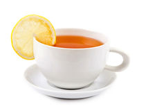 Cup of tea with lemon slice. Isolated on white stock images