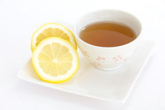 Cup of tea with lemon Stock Photos