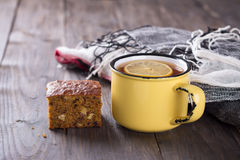 Cup of tea with lemon and a slice of carrot and banana cake Royalty Free Stock Photo