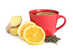 Cup of tea, lemon slices and ginger. On white background stock image