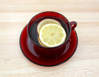 Cup of tea with lemon slices royalty free stock images