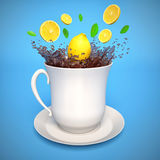 Cup of tea with lemon and splash Royalty Free Stock Photo