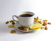 Cup of tea with lemon and sweets Royalty Free Stock Photos