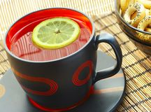 Cup of tea with a lemon on a table Royalty Free Stock Photos