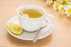 Cup of tea with lemon on table Royalty Free Stock Images