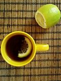 A cup of tea with lemon. On the table Stock Photo