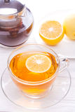 Cup of tea with lemon on table Stock Image