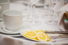 Cup of tea with lemon on table close-up. Royalty Free Stock Images