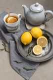 Cup of tea with lemon on table close-up. Healthcare traditional. Medicine and flu concept - tea cup with lemon. Hot tea with lemon treatment of colds flu and Royalty Free Stock Photography