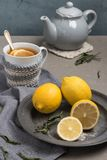 Cup of tea with lemon on table close-up. Healthcare traditional. Medicine and flu concept - tea cup with lemon. Hot tea with lemon treatment of colds flu and Stock Image
