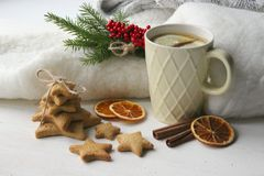 A Cup of tea with lemon on the table close-up surrounded by Christmas decorations and homemade cakes. royalty free stock photos