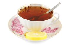 Cup of tea with lemon and teaspoon Stock Images
