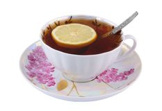 Cup of tea with lemon and teaspoon Stock Image