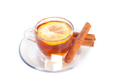 Cup of tea. With lemon on transparent saucer near cinnamon sticks Royalty Free Stock Image