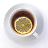 Cup of tea with a lemon Stock Image