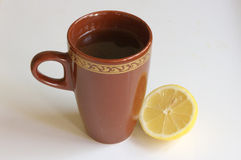 Cup of tea and a lemon Stock Images