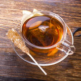 Cup of tea with lemon on wooden background Stock Photos