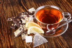 Cup of tea with lemon on wooden background Royalty Free Stock Photo