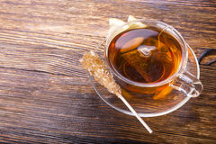 Cup of tea with lemon on wooden background Royalty Free Stock Photography