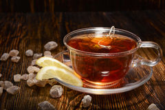 Cup of tea with lemon on wooden background Royalty Free Stock Image