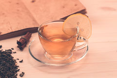 Cup of tea with lemon on wooden background Stock Image
