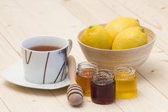 Cup of tea, lemons and honey Stock Image