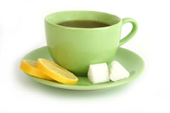 Cup of tea with lemons and lumps of sugar. On white background Royalty Free Stock Image