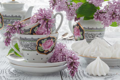 Cup of tea with lilac flowers on white background. Summer tea ti. Me concept. Breakfast tea cup served with flowers Stock Photos