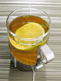 Cup of tea with lime and fresh thyme Royalty Free Stock Photography