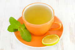 Cup of tea with lime Royalty Free Stock Images