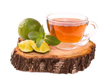 Cup of tea with lime and mint isolated on white Royalty Free Stock Photo