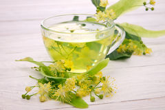 Cup of tea with linden flower Royalty Free Stock Photos