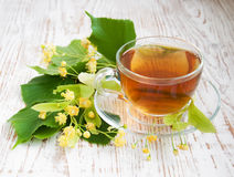 Cup of tea and linden flowers Stock Photography