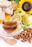 Cup of tea with linden honey, apples, almonds Royalty Free Stock Photo