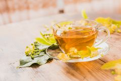 Cup of tea and linden on wooden background Stock Photography