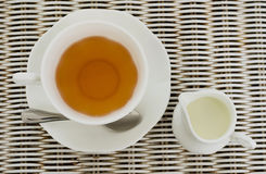 Cup of tea with little milk jar Royalty Free Stock Images