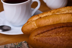 French bread with tea pot and cup on table cloths Royalty Free Stock Photos