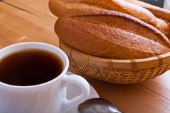 French bread with tea pot and cup on table cloths Royalty Free Stock Image