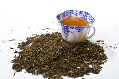Cup of tea and loose tea leaves Stock Images