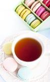Cup of tea with macaron Stock Photos