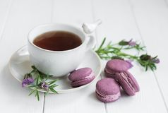Cup of tea and macarons. With fresh lavender on a table Stock Photo