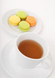 Cup of tea and macarons for dessert Stock Photo