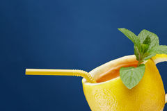 A cup of tea made from natural lemon with mint leaves. Creative composition on the theme of natural tea Stock Photos
