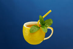A cup of tea made from natural lemon with mint leaves. Creative composition on the theme of natural tea Stock Photo