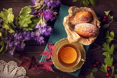 Cup of tea with madeleines. On a wooden backgrouns stock photos