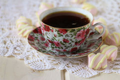Cup of tea and marshmallow on a lace tablecloth. Closeup,selective focus Stock Image