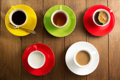 Cup of tea, milk, coffee on wood Royalty Free Stock Images