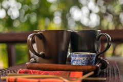 Cup of tea with milk outdoors Royalty Free Stock Photos