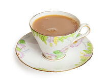 Cup of Tea. With milk in a pretty bone china cup, freshly poured with bubbles on surface, front to back focus, isolated on white background, clipping path royalty free stock image